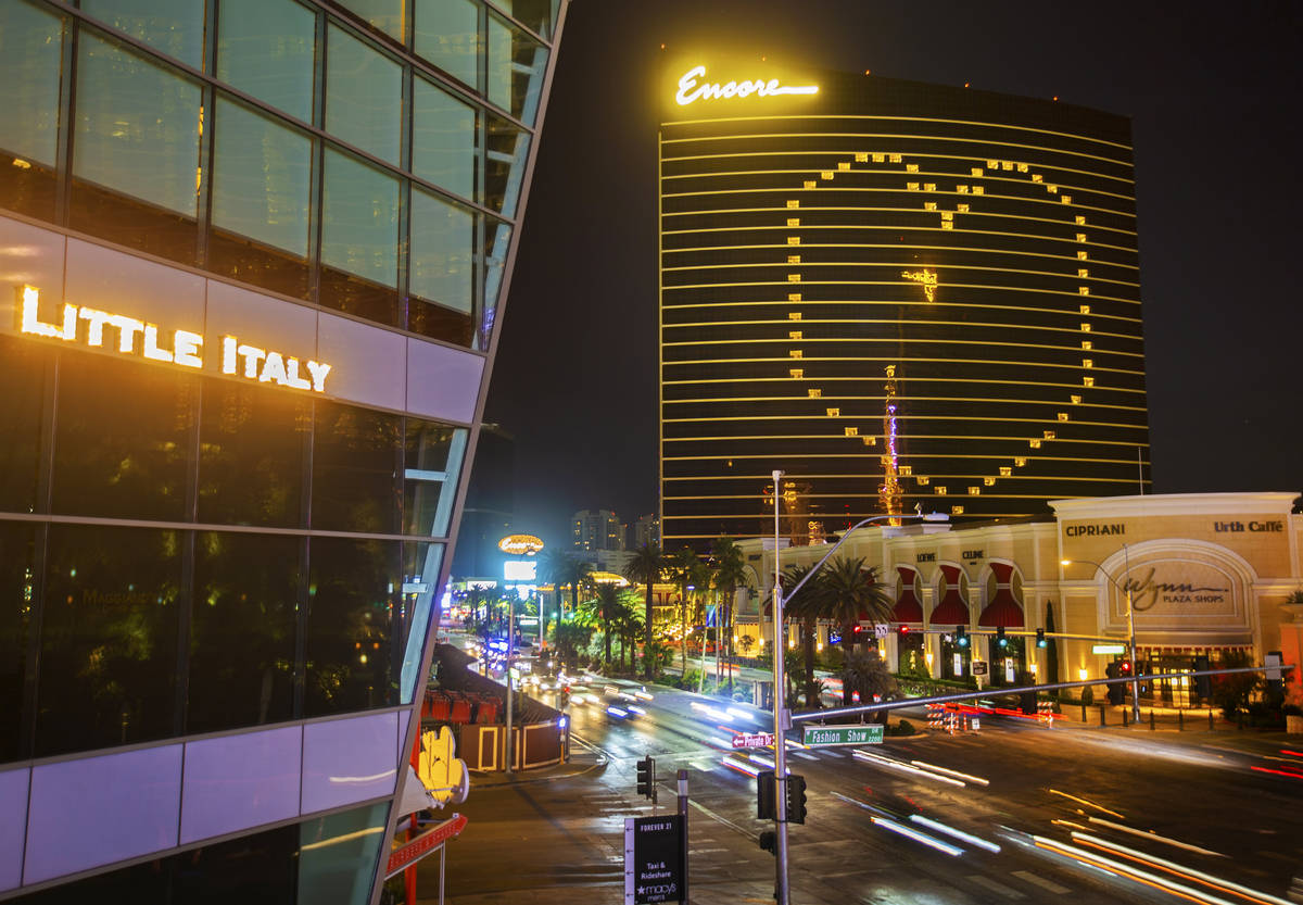 Traffic on the Strip passes by signage on Encore showing support for Las Vegas during the coron ...