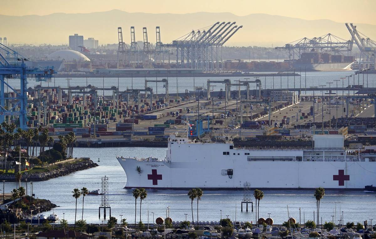 FILE - In this March 27, 2020, file photo, The USNS Mercy enters the Port of Los Angeles in Los ...