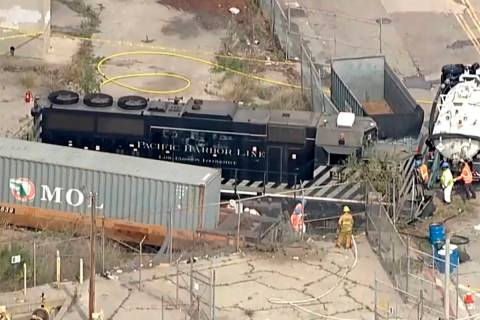 This aerial image taken from video provided by KABC-TV shows a Pacific Harbor Line train that d ...