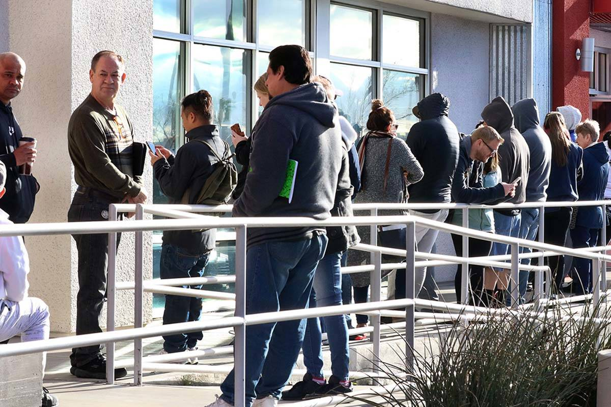 People wait in line at One-Stop Career Center on Tuesday, March 17, 2020, in Las Vegas. (Bizuay ...