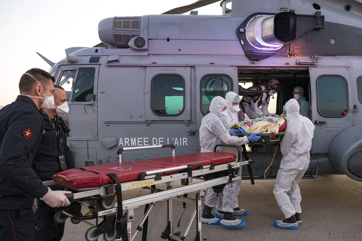 In this photo provided by the French Army Thursday, April 2, 2020, medical staffs evacuate a pa ...