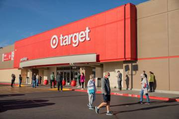 Shoppers line up for Target's early hours at the N Stephanie Street location in Henderson on Tu ...