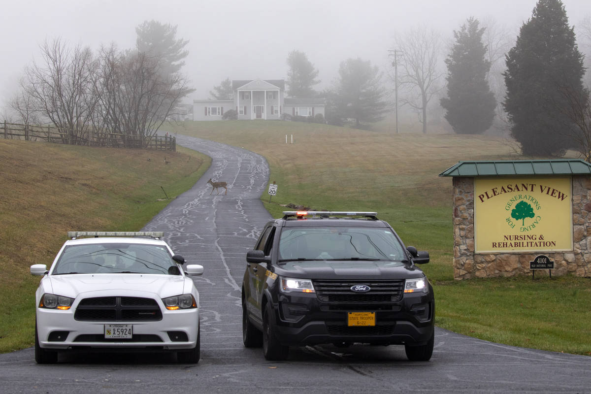 A deer crosses through the fog as a Carroll County Sheriff officer and a Maryland State Trooper ...
