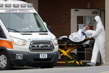A resident is removed from the Gallatin Center for Rehabilitation and Healing, Monday, March 30 ...