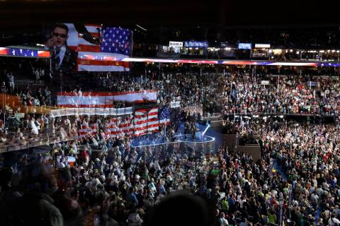 The stage is reflected on a glass window on the suite level at Wells Fargo Arena at the Democra ...
