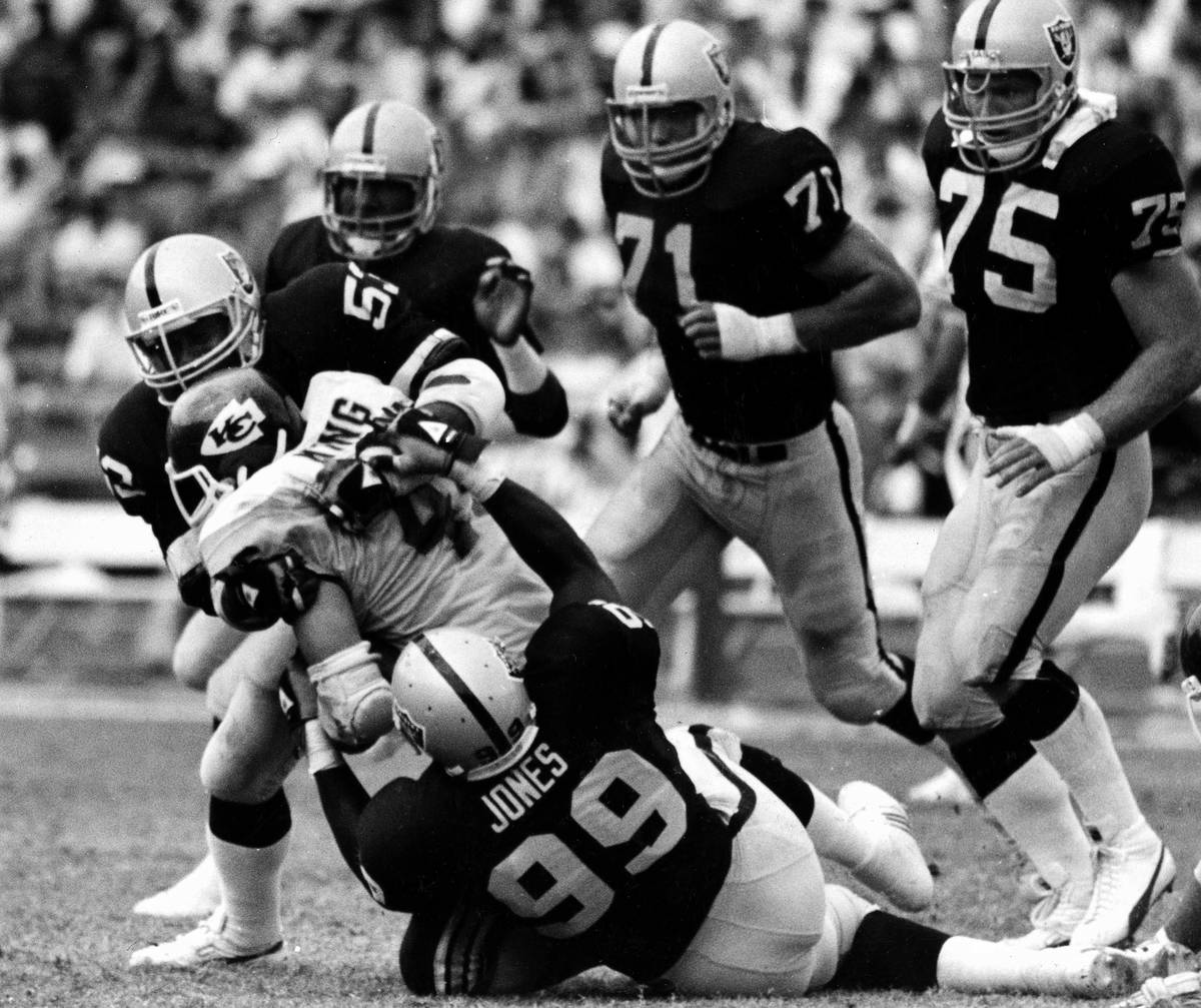 Kansas City Chiefs running back Bruce King is pulled down for no gain by Los Angeles Raiders Ro ...