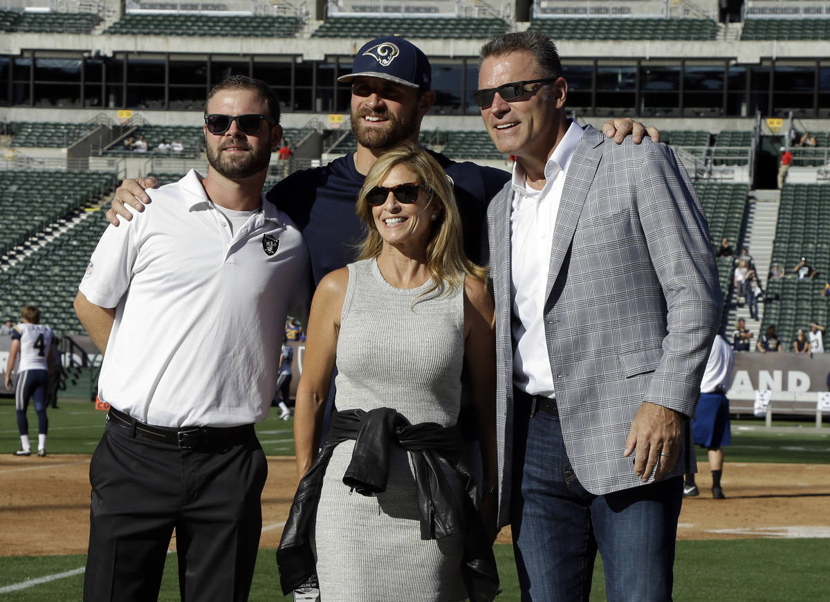 Former NFL player Howie Long, right, poses for photos with his wife Diane Addonizio, center, an ...