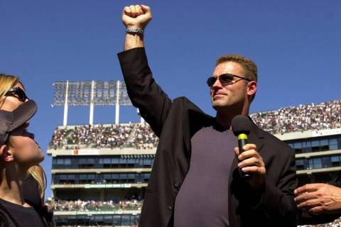 Former Oakland Raiders defensive lineman Howie Long holds up his arm at halftime during the Rai ...