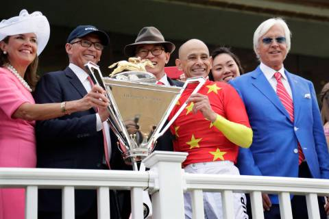 Jockey Mike Smith, second from right, trainer Bob Baffert, right, and owners Kenny Trout, secon ...