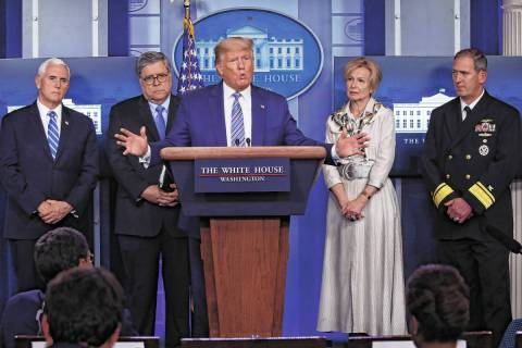 President Donald Trump takes questions from reporters as he speaks about the coronavirus in the ...