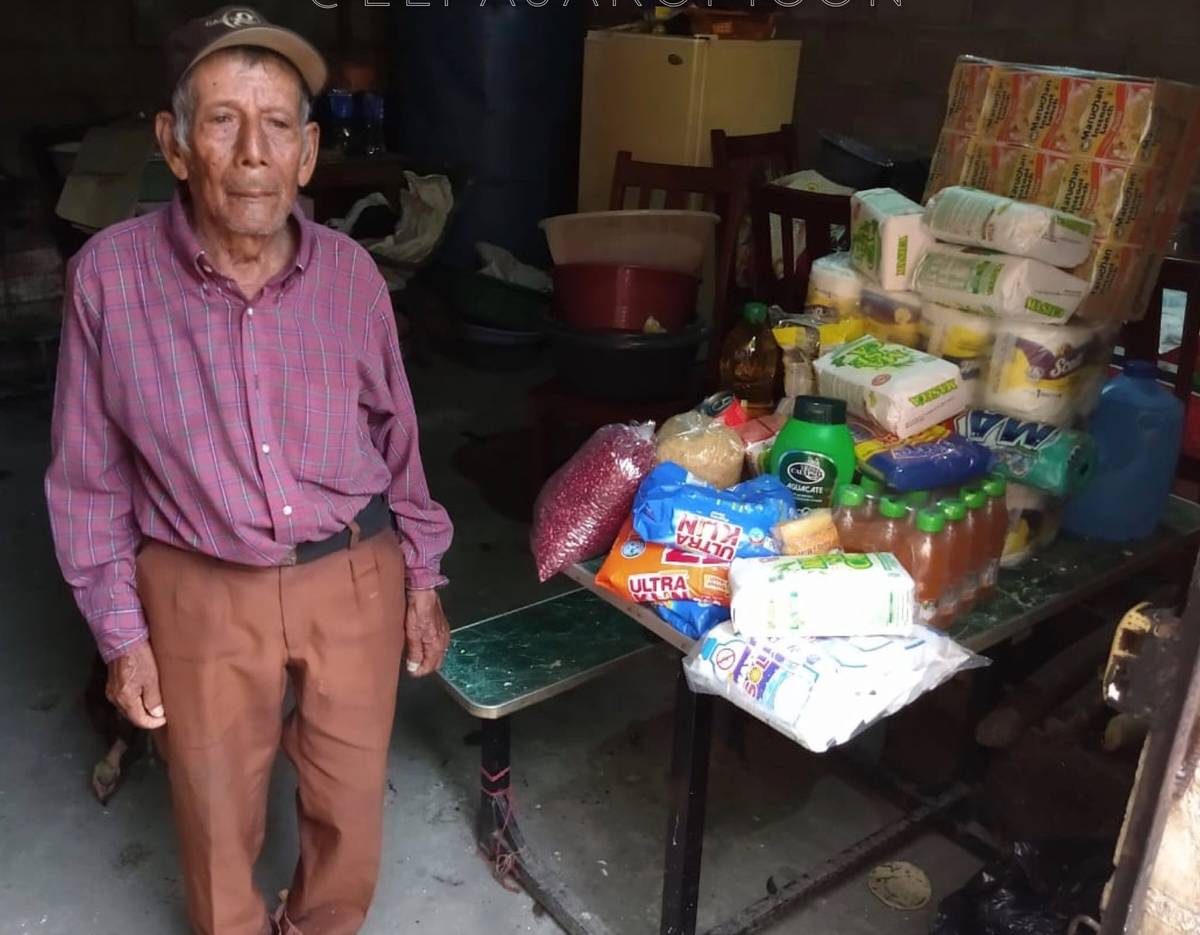 Manuel Aretega, a street vendor in El Salvador, is shown with groceries purchased by Lights FC ...