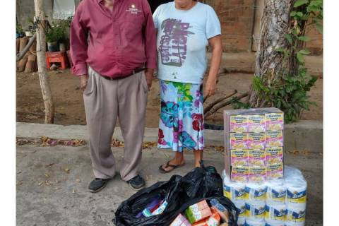 "Jose ""Chepito"", a street vendor in El Salvador, and an unidentified woman are shown with grocer ..."