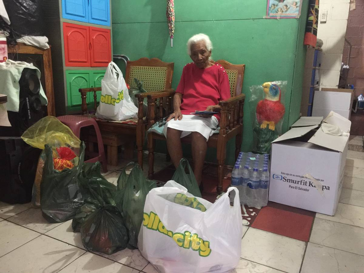 Maria Luisa, 98, is shown with groceries purchased by Lights FC soccer player Junior Burgos dur ...