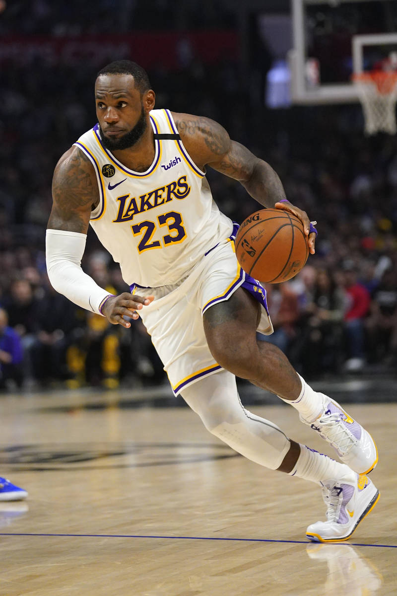 Los Angeles Lakers forward LeBron James drives toward the basket during the second half of an N ...