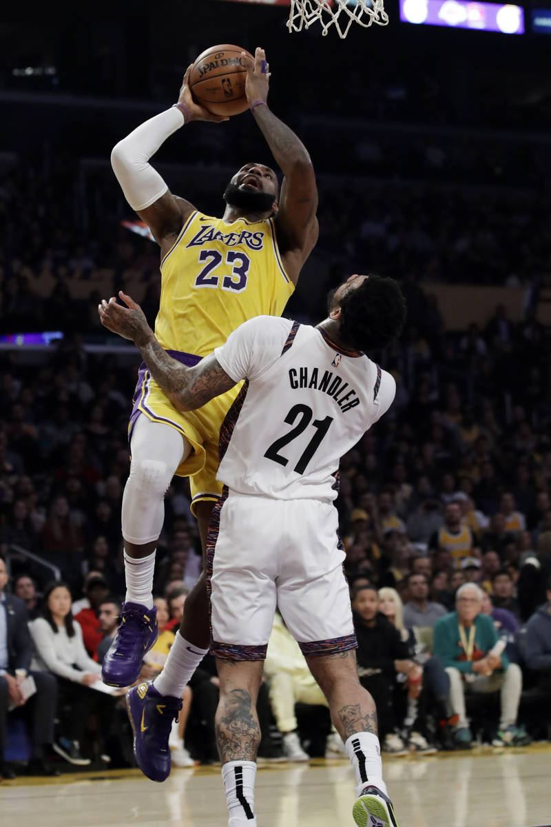 Los Angeles Lakers' LeBron James (23) shoots over Brooklyn Nets' Wilson Chandler (21) during th ...