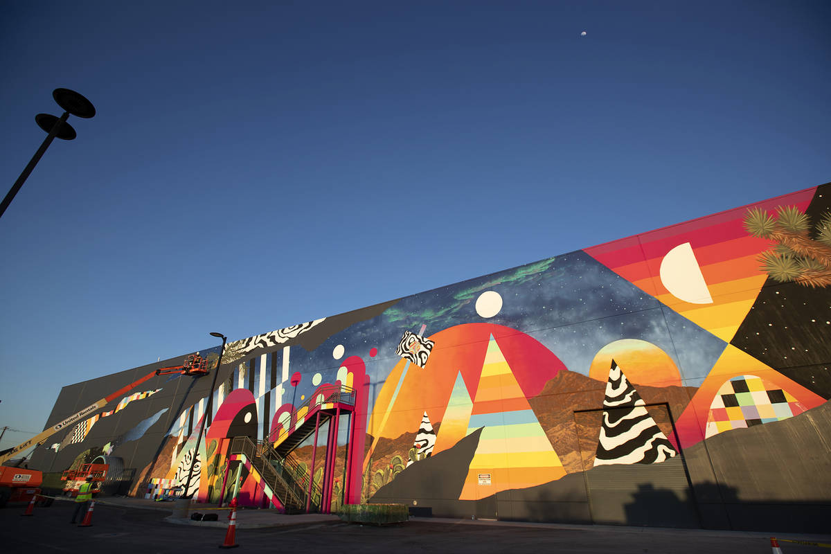 Eric Vozzola working on his mural at Area 15, Las Vegas, NV ( Kate Russell, Courtesy of Meow Wolf)