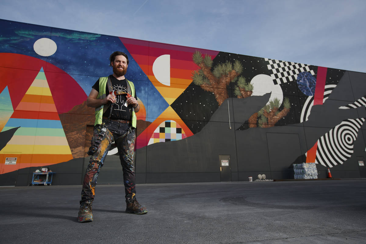 Eric Vozzola and his mural at Area 15 in Las Vegas. ( Kate Russell, Courtesy of Meow Wolf)