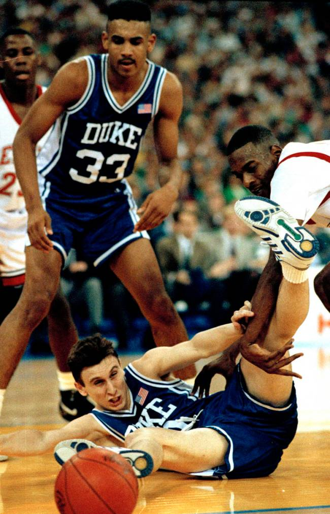In this May 30, 1991, file photo, Duke's Bobby Hurley goes to the floor after the basketball as ...