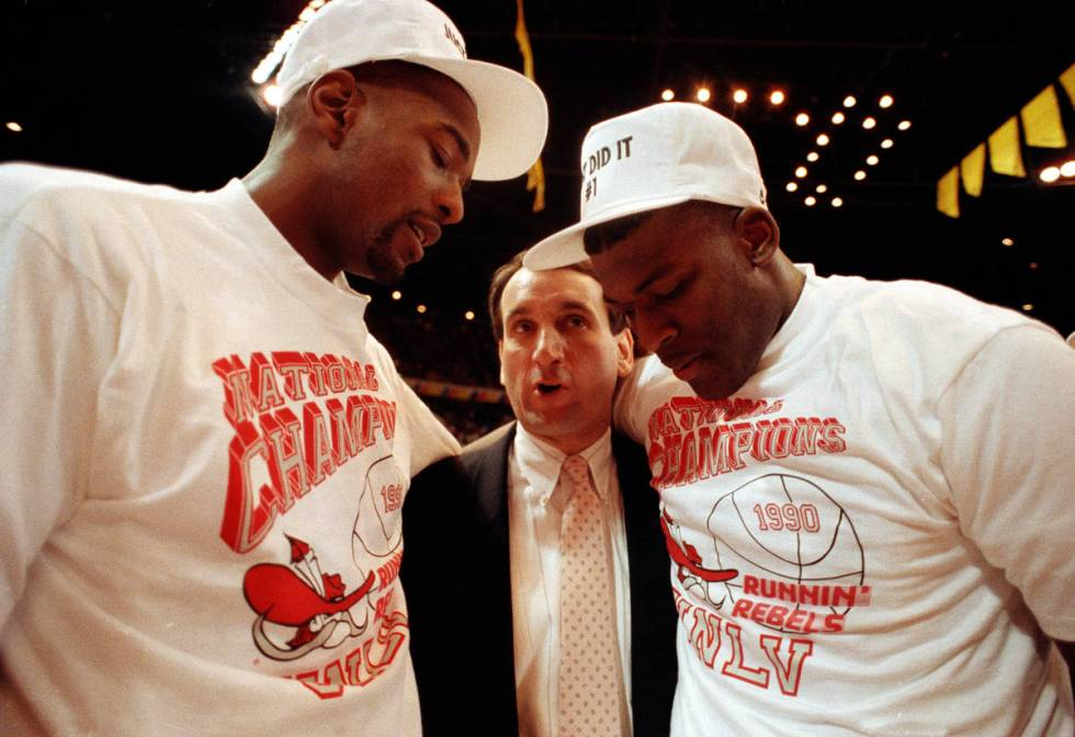 Duke coach Mike Krzyzewsik, center, offers his congratulations to UNLV players Stacey Augmon, l ...