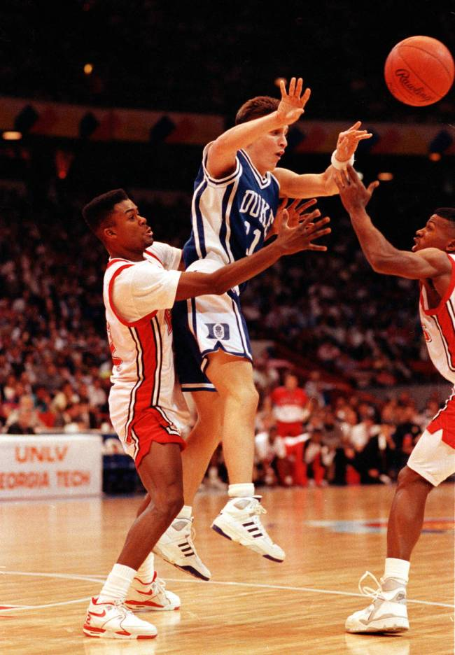 Duke guard Bobby Hurley is trapped by UNLV guard Anderson Hunt, left, and Stacey Augmon, right, ...