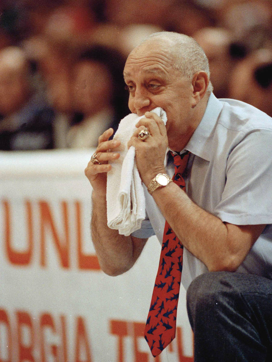 FILE - In this April 2, 1990, file photo, UNLV coach Jerry Tarkanian chews on his towel while w ...