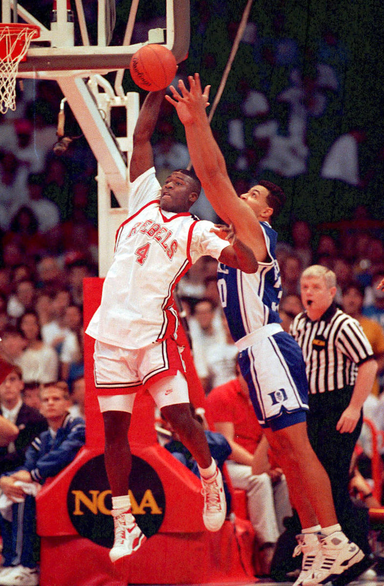 FILE*** HISTORIC *** UNLV basketball forward Larry Johnson gets off shot beyond the defensive ...