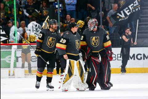 Golden Knights goaltenders Marc-Andre Fleury (29) and Robin Lehner (90) talk alongside Chandler ...