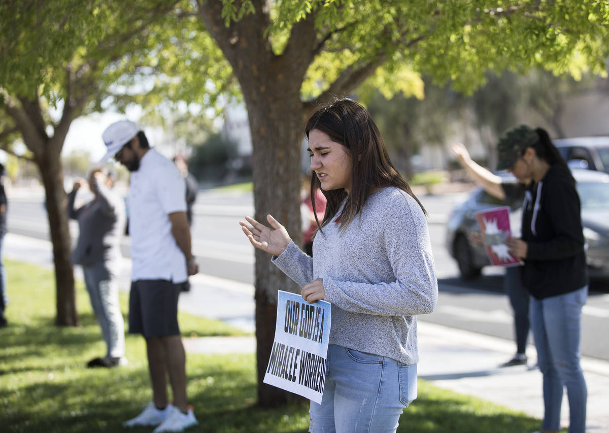 Dariahne Navarro, 16, center, prays with family and friends for her cousin Adriana Huh who is i ...