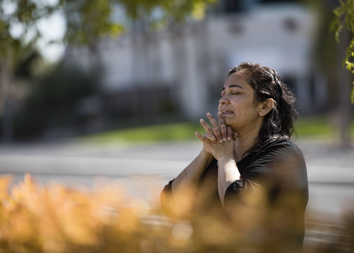 Elena Romero prays with family and friends for her niece Adriana Huh who is in the hospital wit ...