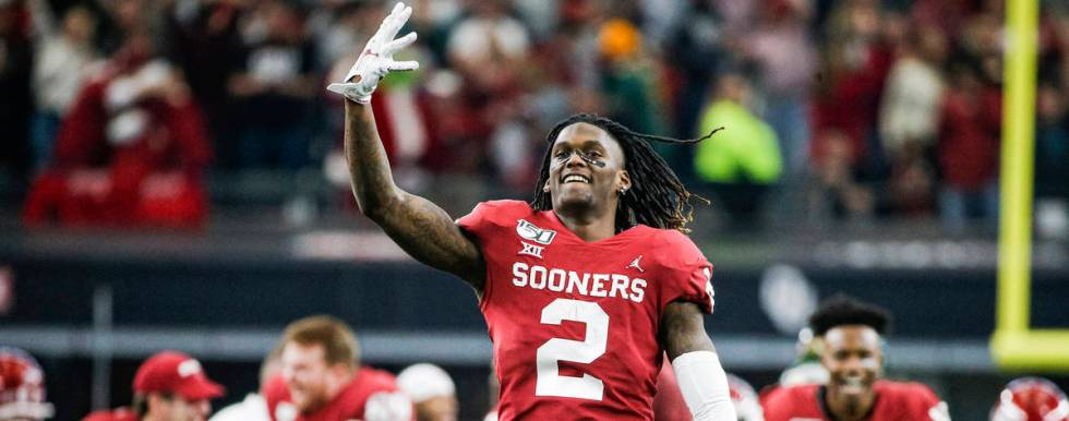 Oklahoma wide receiver CeeDee Lamb (2) celebrates a 30-23 overtime win against Baylor during th ...