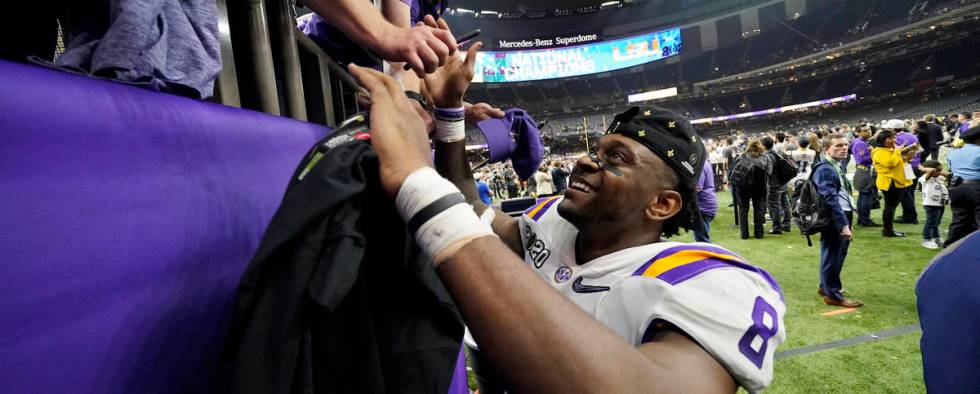 LSU linebacker Patrick Queen leaves the field after their win against Clemson in a NCAA College ...