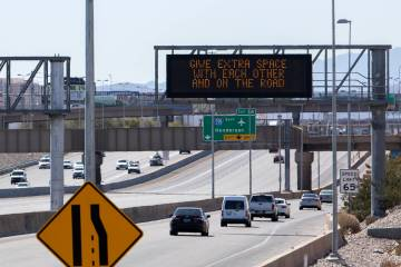 A Nevada Department of Transportation sign sends a message of traffic safety and COVID-19 socia ...