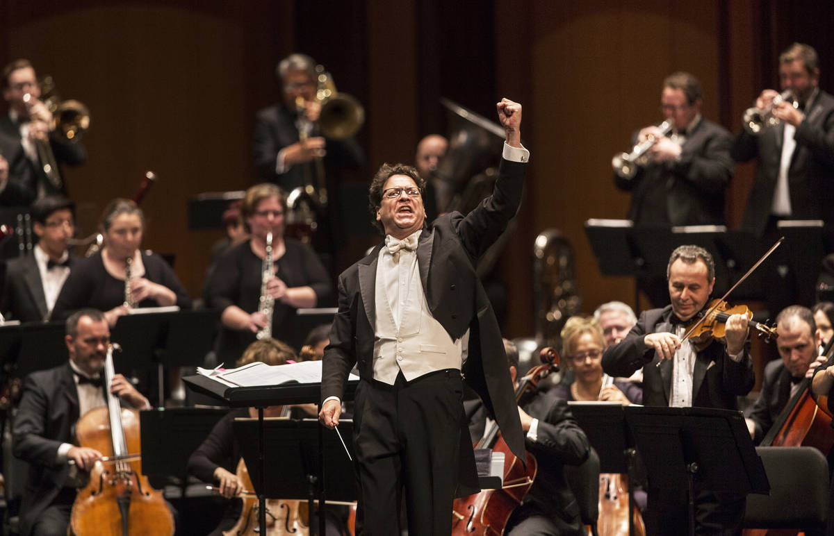 Music Director Donato Cabrera salutes the audience before the start of a performance by the Las ...