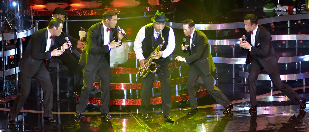 Performing with saxophonist Tommy Alvarado, center, are from left, Phil Burton, Toby Allen, Mik ...