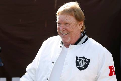 Oakland Raiders owner Mark Davis smiles before an NFL football game between the Raiders and the ...