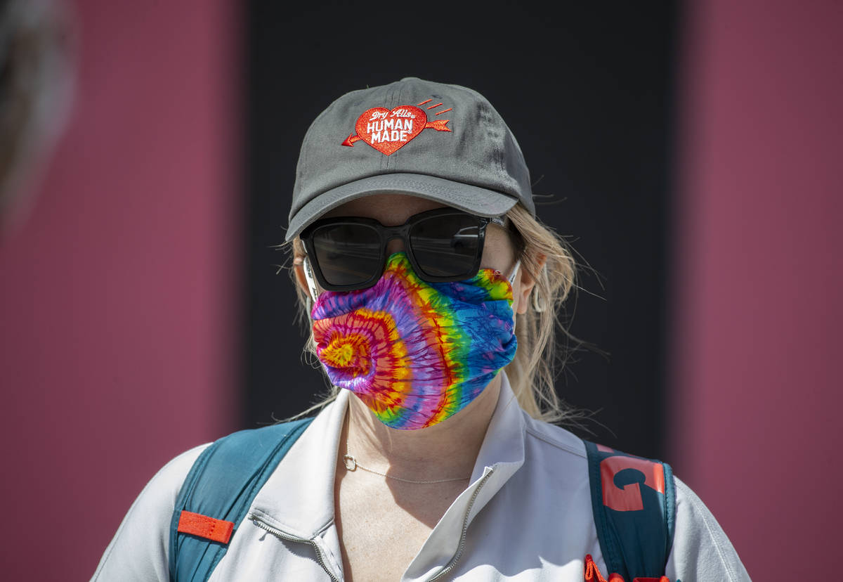 Porsha Willey wears a protective mask in downtown Las Vegas on Friday, April 3, 2020. (Benjamin ...