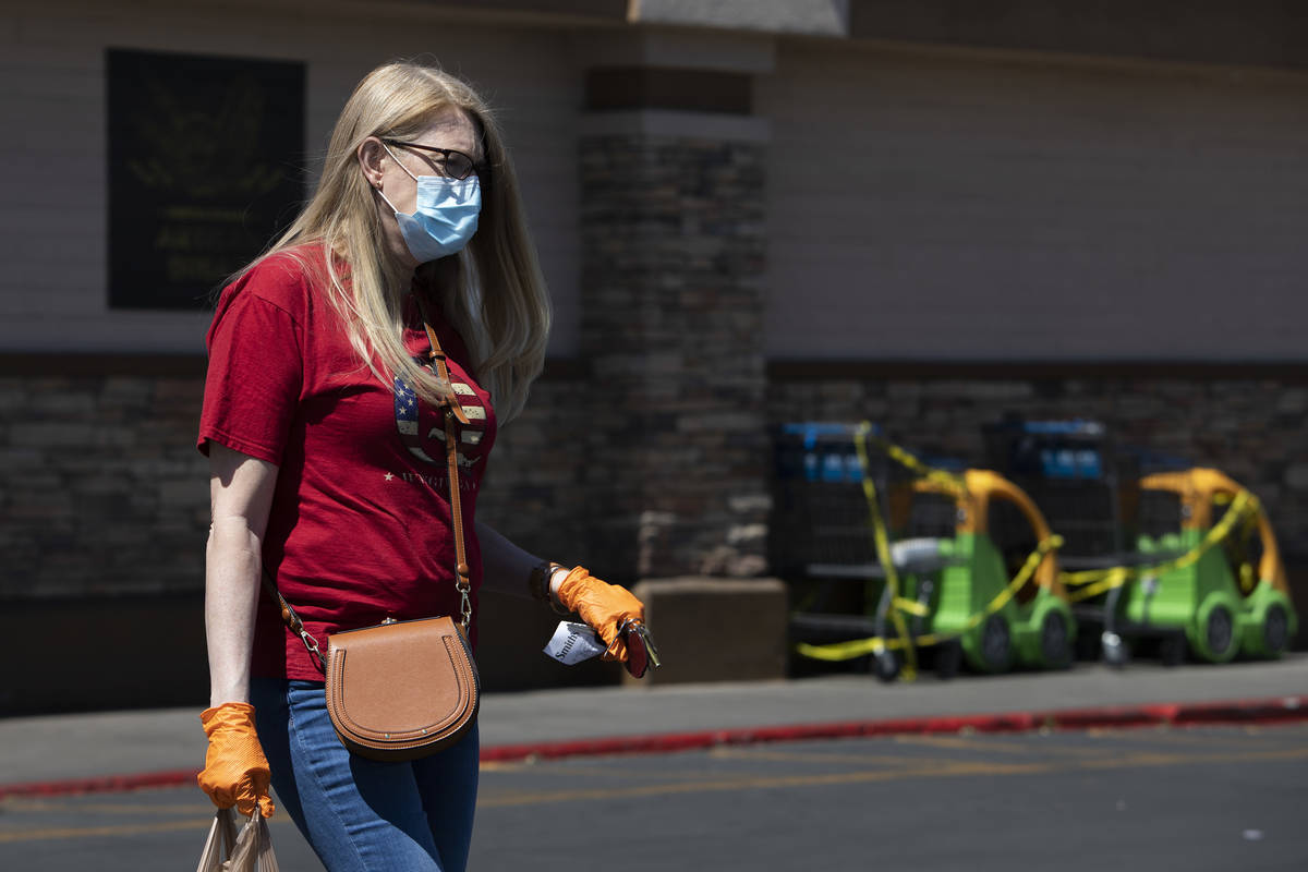 Local teacher Larissa Ellison wears a mask and gloves after getting groceries at Smith's Food a ...