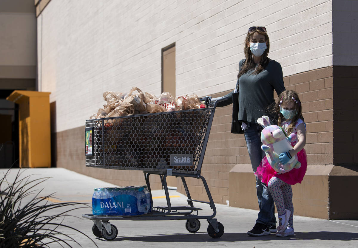 Leslie Attisani and her daughter Lily Attisani wore masks and gloves to their grocery store tri ...
