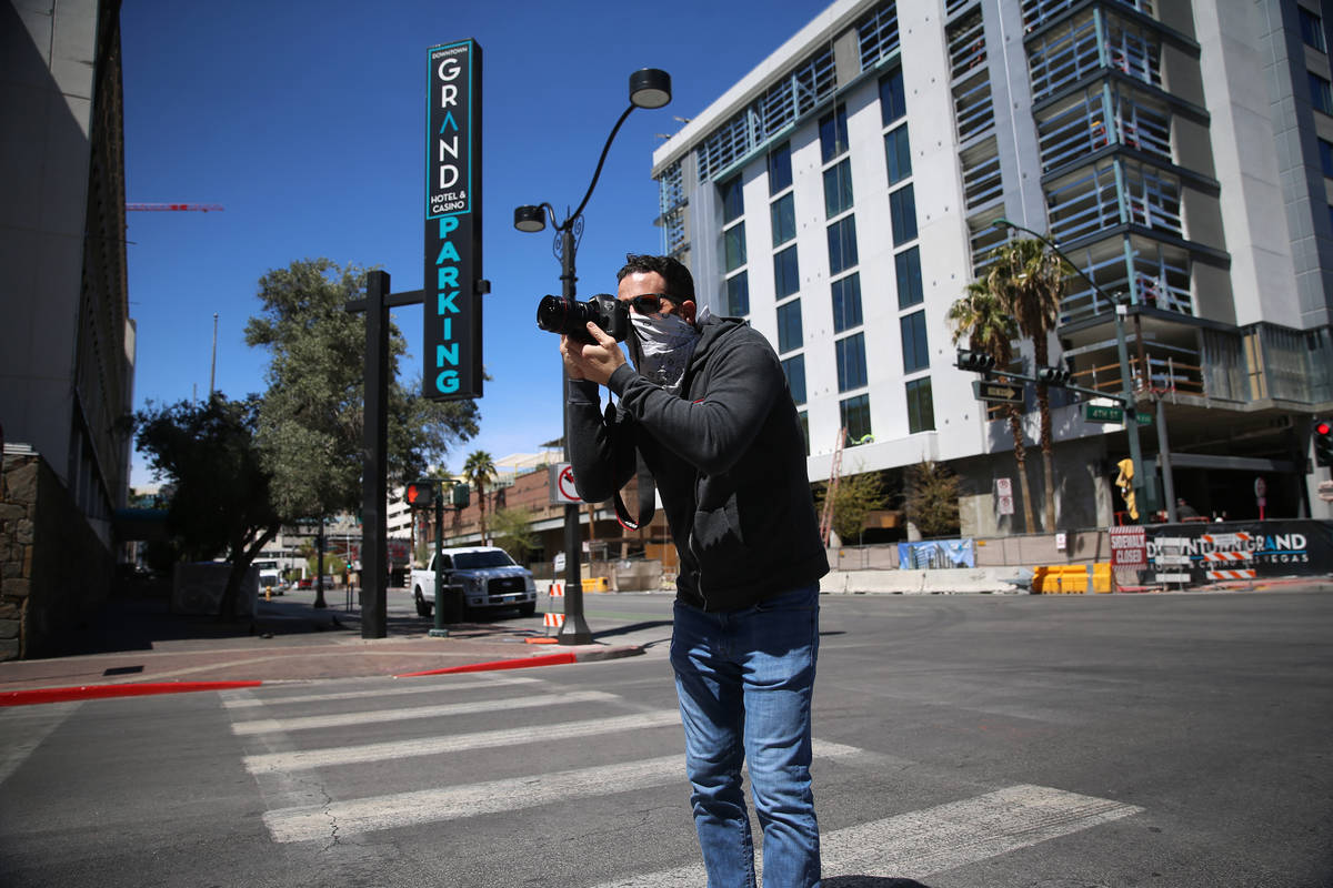 Advertising photographer Greg Anderson takes a photo in downtown Las Vegas wearing a bandana to ...