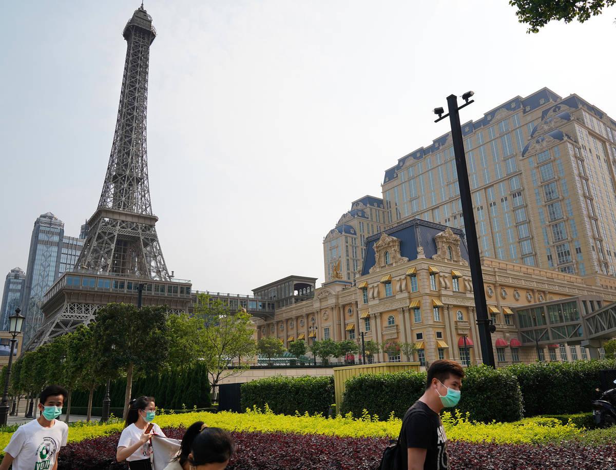 People walk along the sidewalk near the Parisian Macao on April 10, 2020. (Inside Asian Gaming)