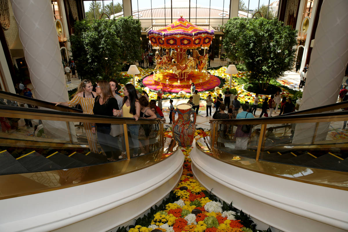 Guests explore the Garden Lobby and a Preston Bailey carousel during the opening of the $2.6 bi ...