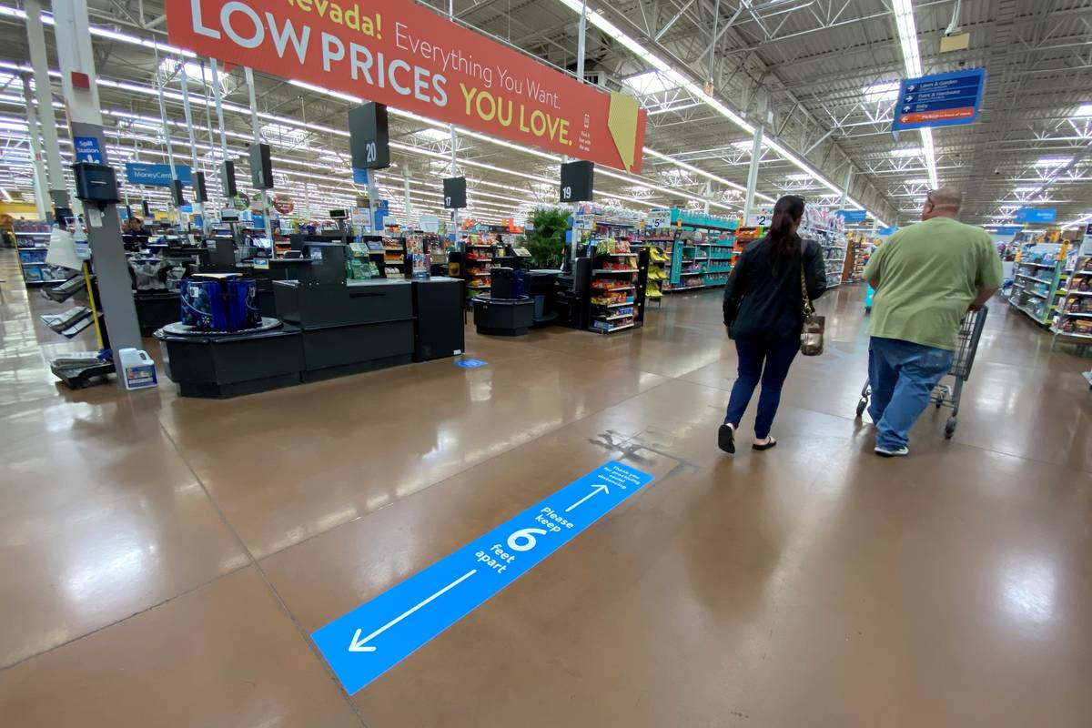 Social distancing markings on the floor at Walmart Supercenter at 3950 W. Lake Mead Blvd. in No ...