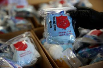 The Salvation Army Lieutenant Heather Baze hands out pandemic kits to the homeless in North Las ...
