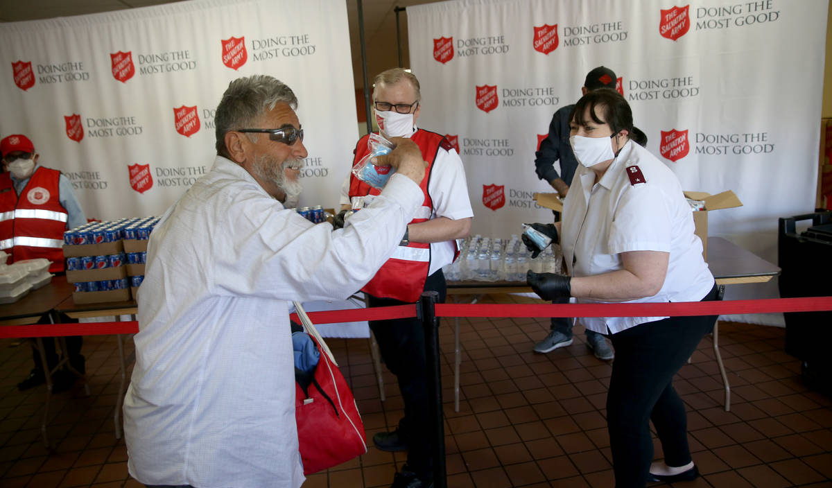 The Salvation Army Lieutenant Heather Baze gives a pandemic kit to Martin Borunda, 62, in Nort ...