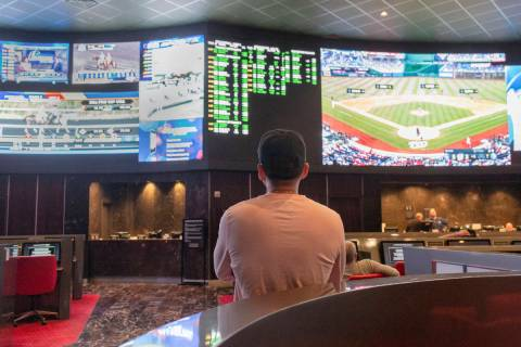 Betters watch live sports at the CG Technology sports book at the newly renovated Palms in Las ...