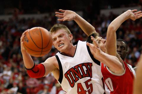 UNLV basketball player Joe Darger grabs a rebound against New Mexico during their game at the T ...