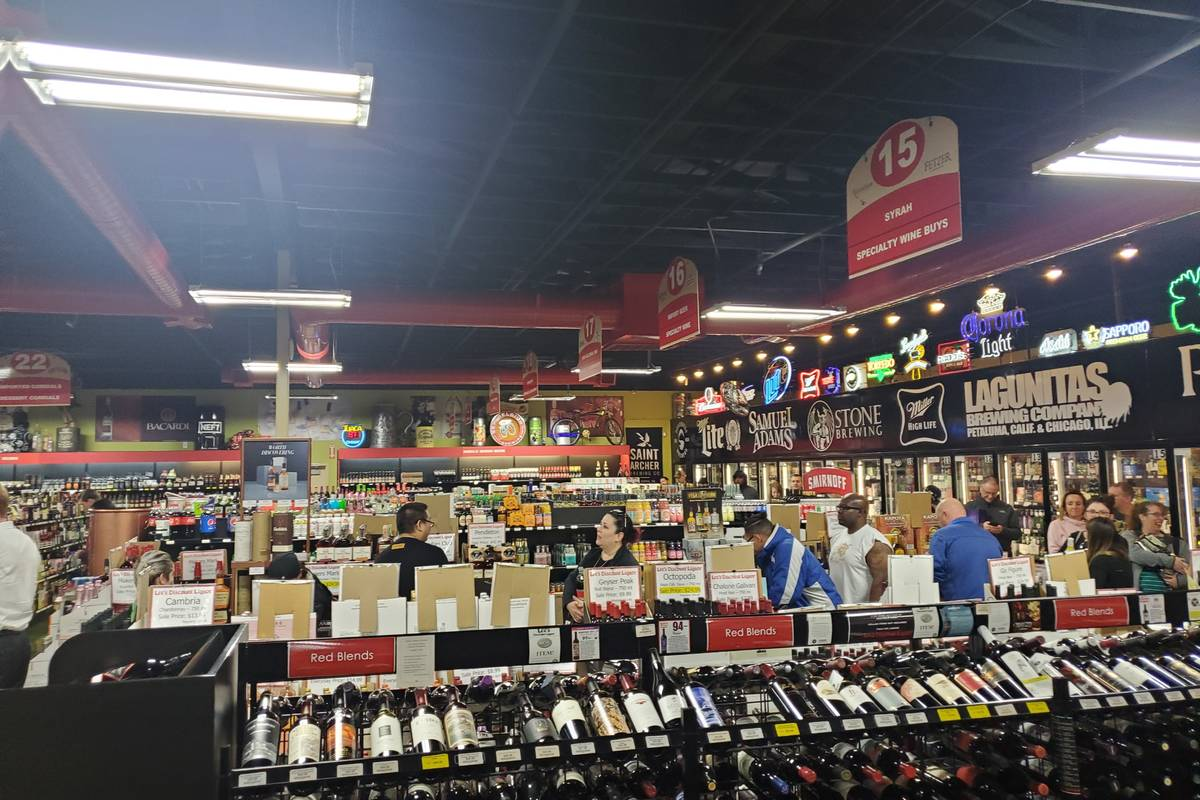 The line to the cashier at a Lee's Discount Liquor in March 2020. (Adam Hill/Las Vegas Review-J ...