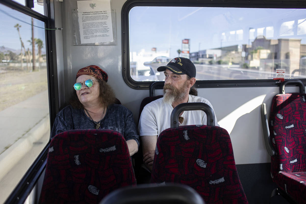 Debbie Holmgren, left, and Todd Henke ride a bus from Laughlin, Nev. to Bullhead City, Ariz., o ...