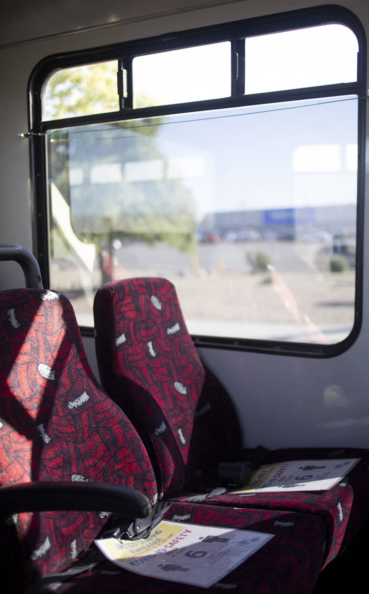 A sign reserves seats to maintain social distancing and COVID-19 safety while the bus pulls int ...