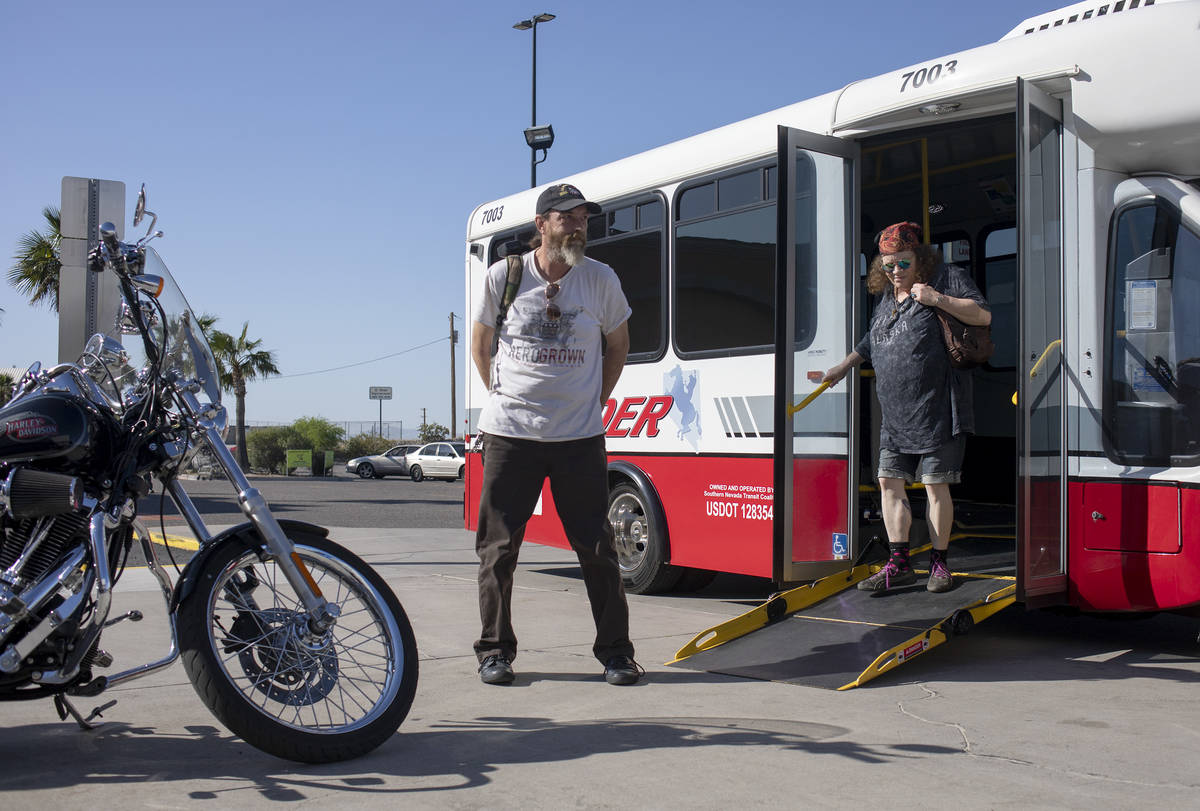 Todd Henke, left, and Debbie Holmgren, right, exit the bus before heading into Walmart on Satur ...